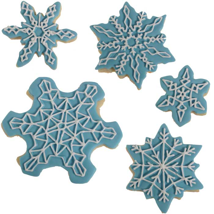 White Piped Snowflake Cookies on Blue Fondant